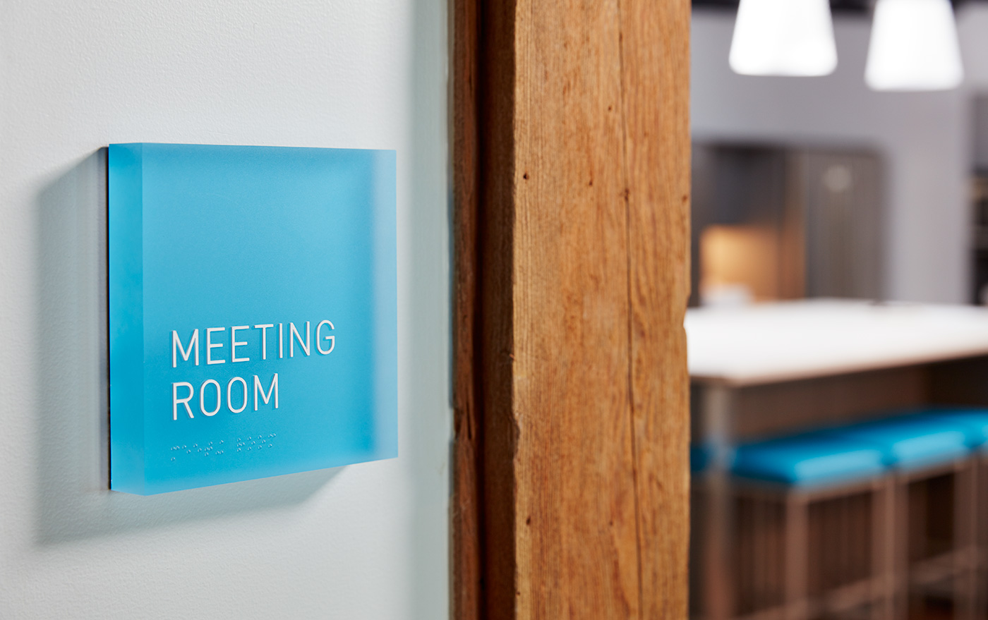 Close up of blue meeting room sign