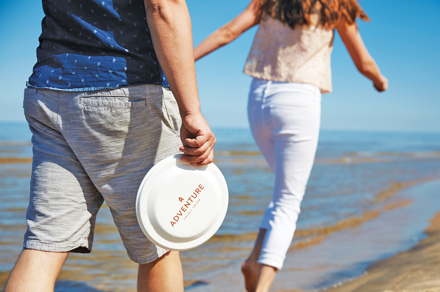 Adventure Credit Union frisbee on beach