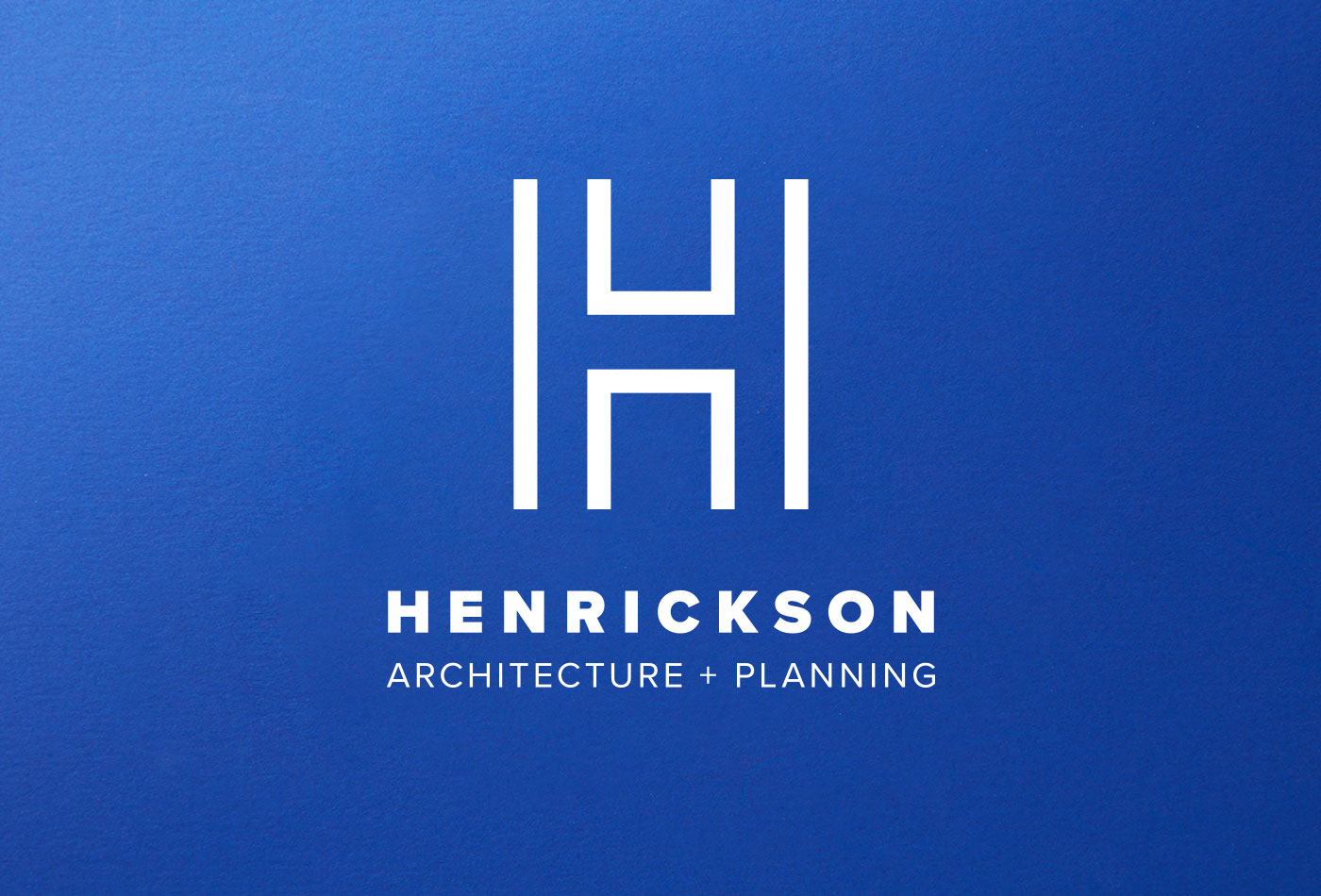 Henrickson Architecture logo on blue background