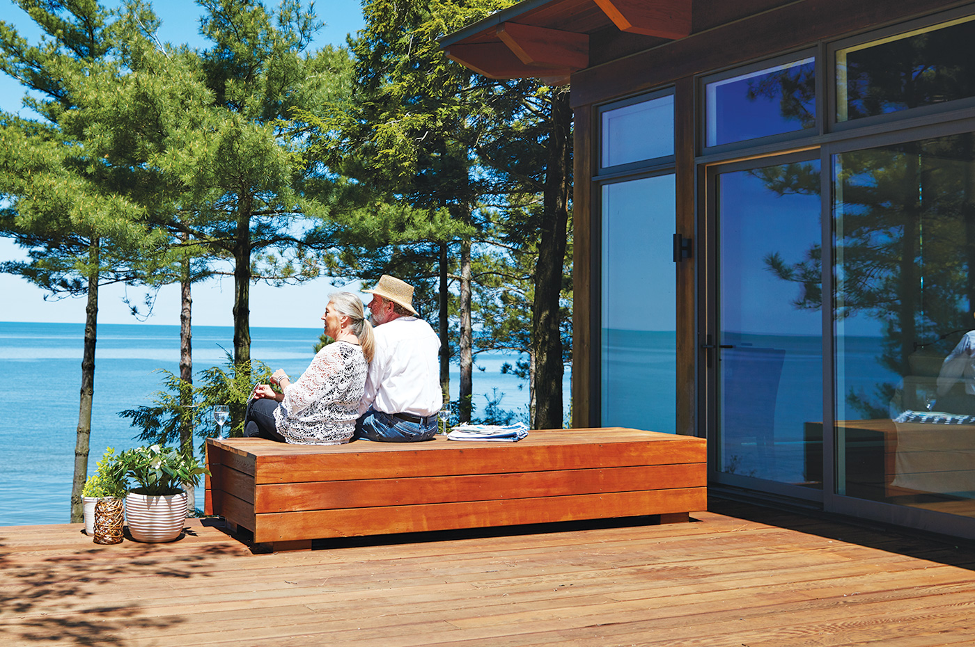 Adventure Credit Union couple on patio overlooking Lake Michigan