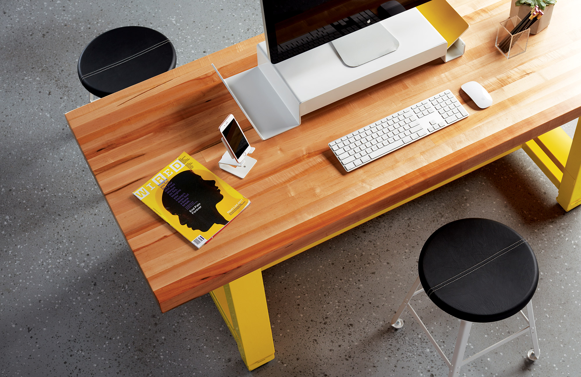 Yellow desk with computer monitor.