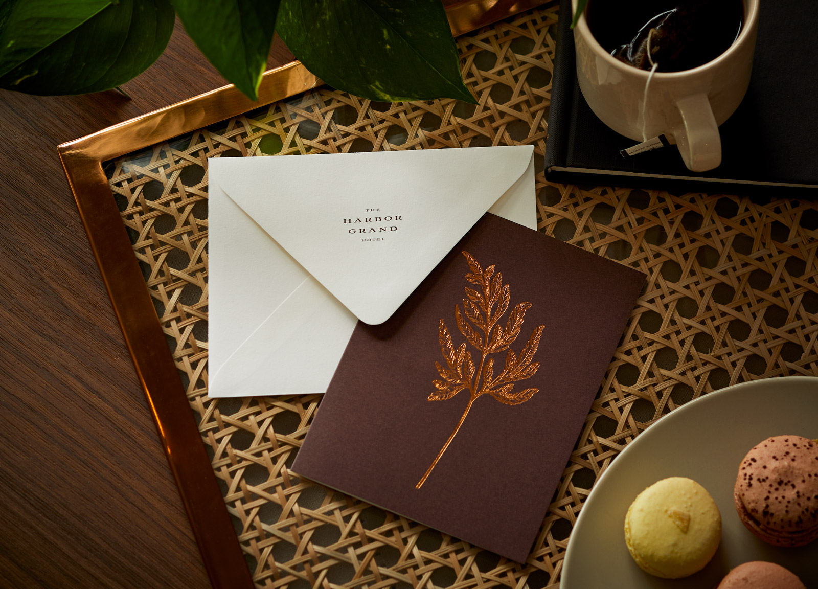 Greeting card with bronze botanical foil stamp and envelope with The Harbor Grand Hotel logo