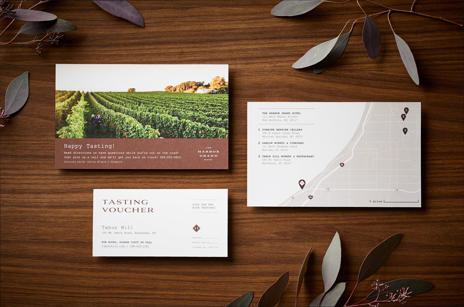 wine tasting vouchers and map on a wood background