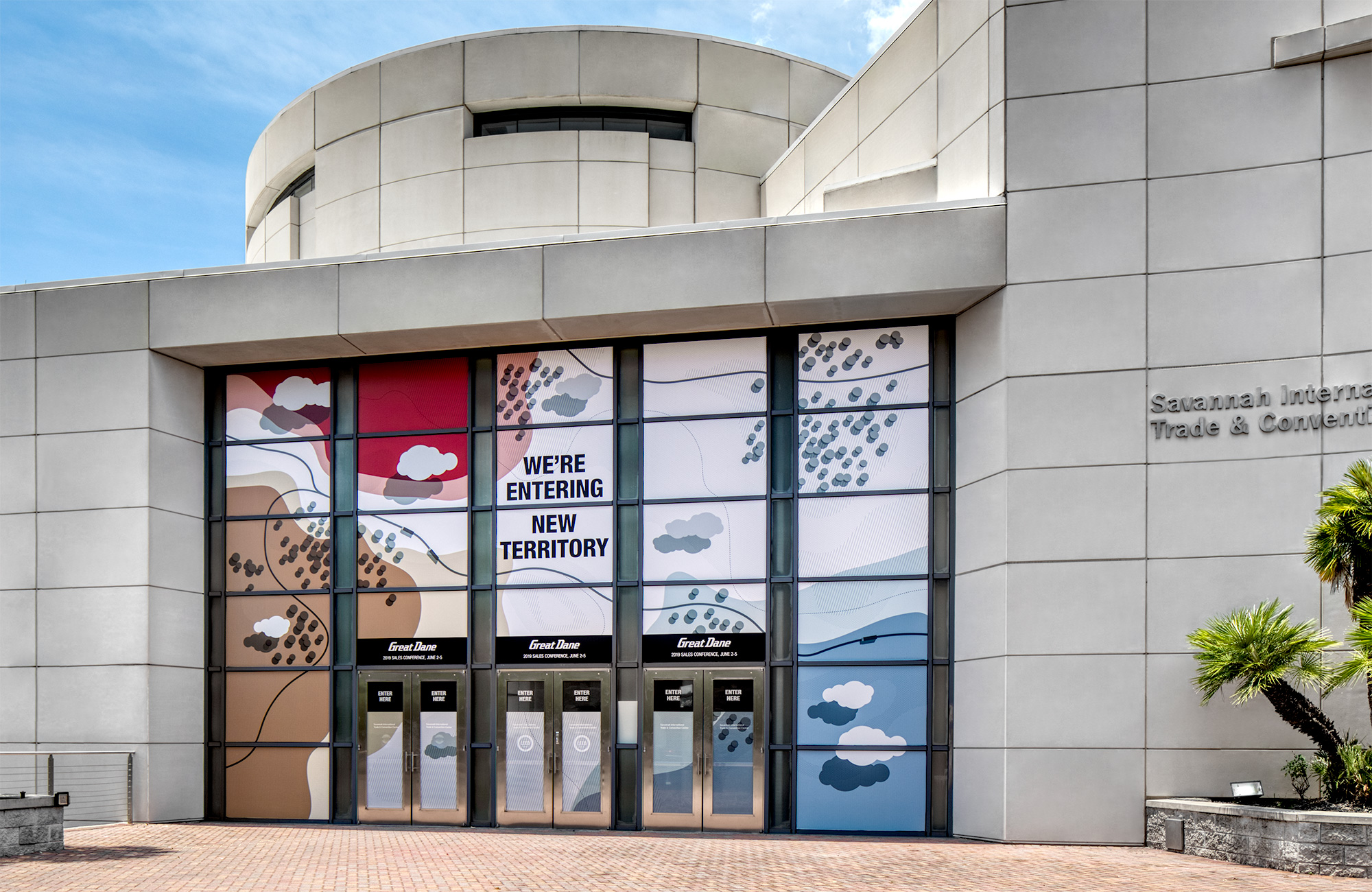 Savannah Convention Center entrance with topographic map graphics