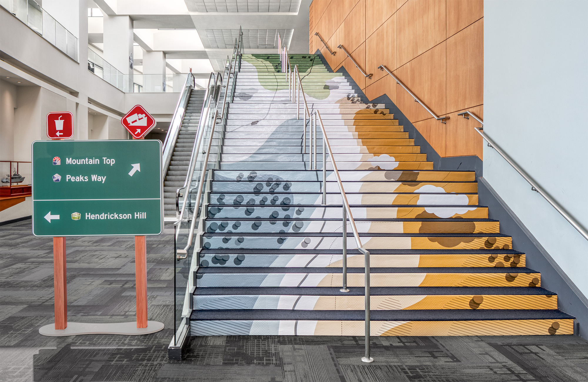 The topographic map illustration wrapped up the stair risers inside of the Savannah Convention Center